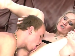 Sexually excited and insane granny named Angeline receives an amazing cunnilingus from her young fucker