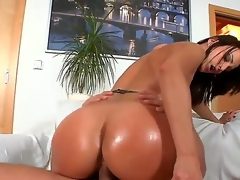 Dark haired doxy Simone Style with huge jaw dropping ass and cheep make up in lingerie and high heels rides on young stud Meeo to loud agonorgasmos in living room action.