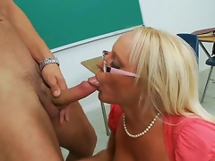 Gorgeous spectacled blonde teacher Alexis Golden is having worthy sex with her student Danny Mountain in this movie. She is kneeling and starting to perform sexy fellatio.