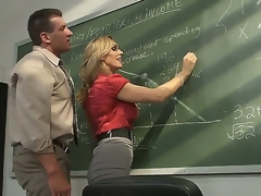 Awesome blond milf pornstar Tanya Tate with a big and very tasty boobs seduces her student in the classroom. This hot whore receives licked on a table and with a fun sucks a cock.