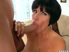 Turned on knob hungry black haired mature cougar Shay Fox with biggest firm balloons and big soaked ass rubs her shaved minge and gives lusty blowjob to youthful dude with huge cock.