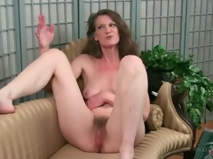 Mature disrobes bare to show her hairy pussy