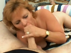 Sexually excited blond grandmother Megan sucking a big young prick with lust