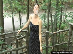 Open-air milf smoking