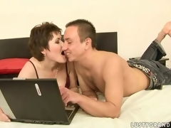 Sexy mature woman and a horny dude making love